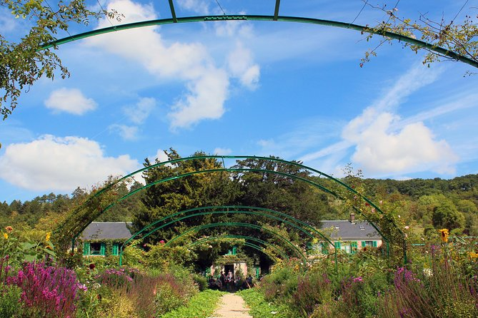 Versailles Palace and Monet's Giverny House Full Day Tour from Paris