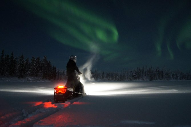 Northern Lights Snowmobile Safari with Finnish Picnic and Bonfire