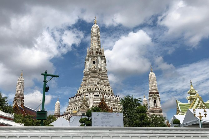 Wat Arun and National Museum of Royal Bargues Charter Boat by Supatra