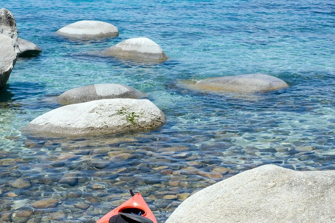 Kayaking Lake Tahoe combines the splendor of the crystal clear water with magnificent mountain scenery