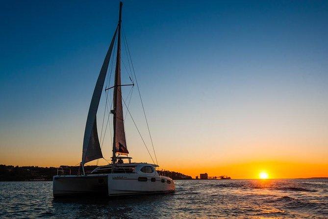 Lisbon sunset and monuments on a Catamaran sail boat