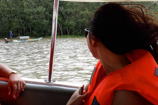 Speed boat to Cu chi tunnels with experienced guide