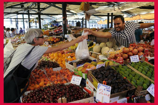 Local market visit and dining experience at a local's home in Verona