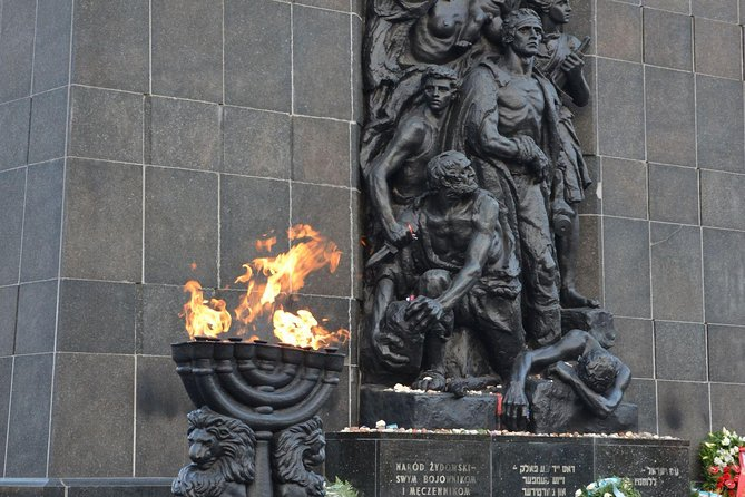 Monument for the Jewish History in Warsaw next to a burning flame