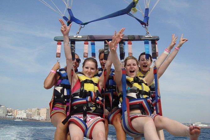 Enjoy a parasailing flight on the coast of Ibiza