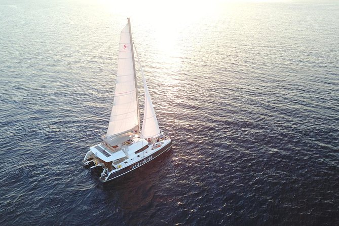 Santorini Luxury Catamaran Sunset Cruise with BBQ, Drink and Transfer