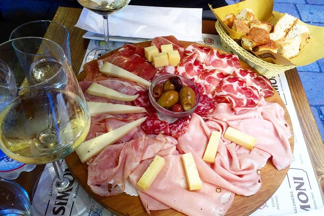 Cold cuts board and glass of wine*