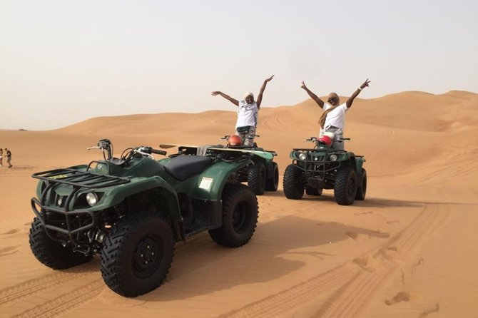 Dubai Self-drive Quad Bike, Sand Boarding, Camel Ride and Refreshments at Camp