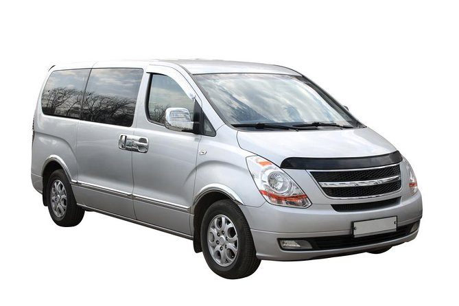 Round trip transfer in private minivan from-to Prague Airport in Prague City
