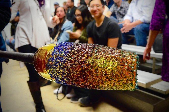 A glass art piece being made.