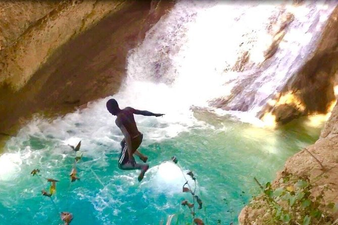 A Local guide showing off at the waterfall