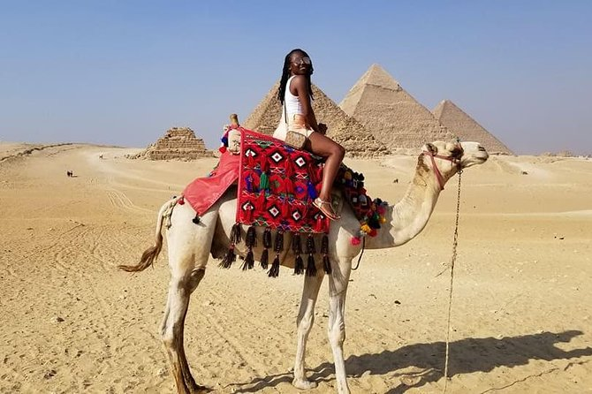 Desert safari at Giza Pyramids with Quad Bike and camel Riding during sunset