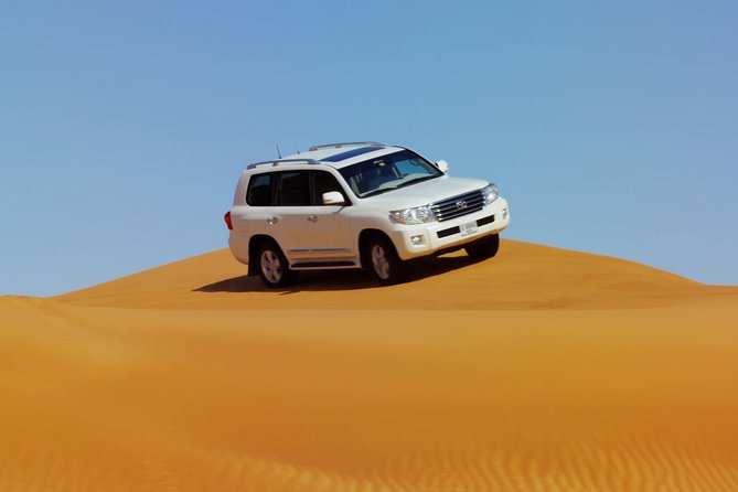 Dubai Red Dune Safari with BBQ Dinner & Live Shows from RAK