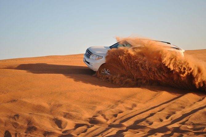 Abu Dhabi Desert Safari Dune Bashing & Camels & Camping With Belly Dance & BBQ
