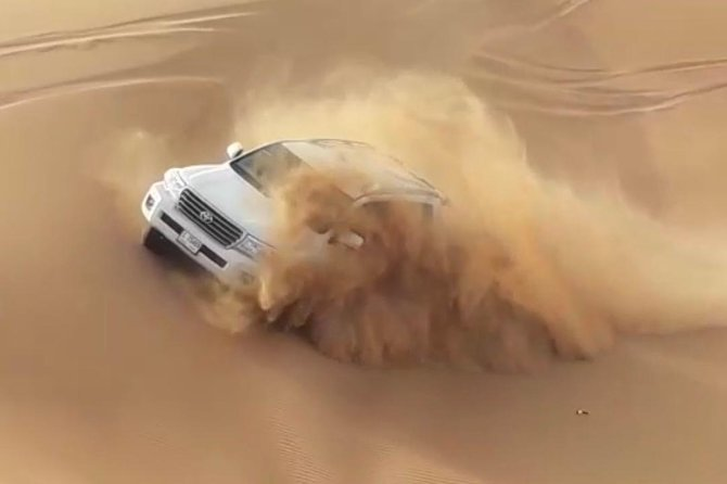 Dubai Evening 4x4 Desert Safari with BBQ, Sandboarding & Camel Ride photo 5
