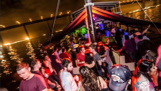 Boat party by night in Rio de janeiro with transportation