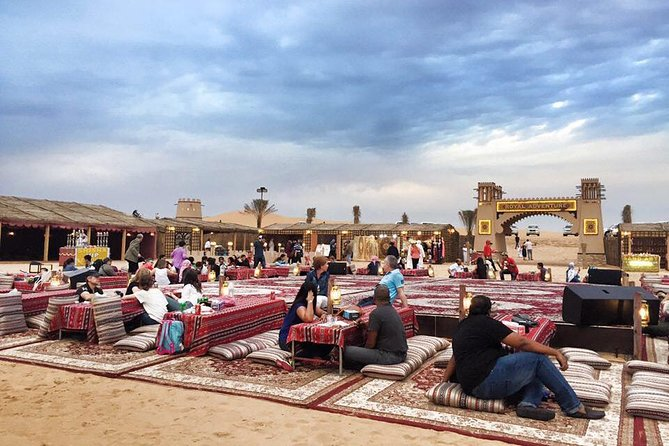 Red Desert Safari with BBQ Dinner, Camel Ride, Sand boarding And Much More