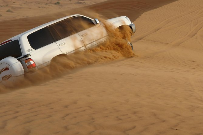 Abu Dhabi Desert Morning Safari: 4x4 Dune Bash, Camel Ride and Sandboarding