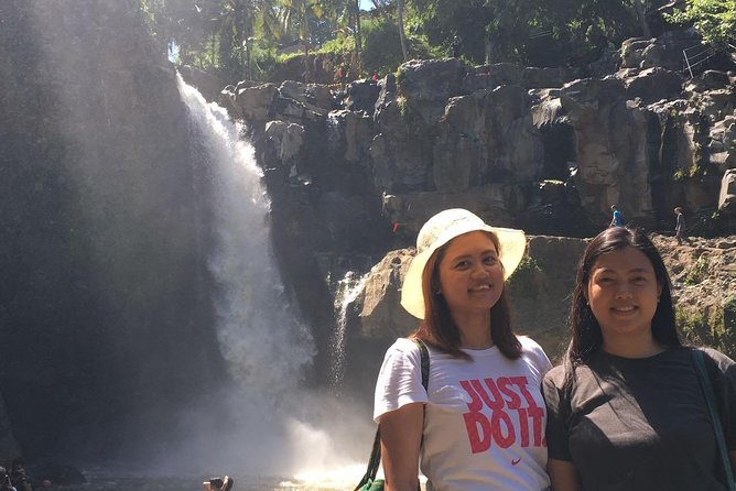 Sunset at Tanah Lot Temple - Tagenungan Waterfall and Ubud Tour