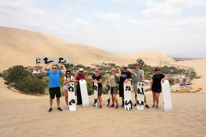 Dune buggy & Sandboarding around Huacachina Oasis & Ballestas Islands day tour
