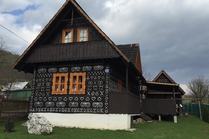Cicmany village, hidden gem - wooden houses painted with white ornaments