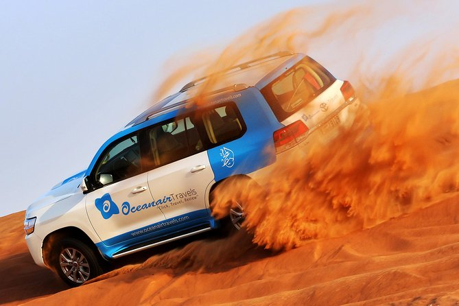 Abu Dhabi: 7-Hours Desert Safari with BBQ, Camel Ride & Sandboarding