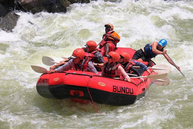 White Water Rafting & Swimming under the Falls