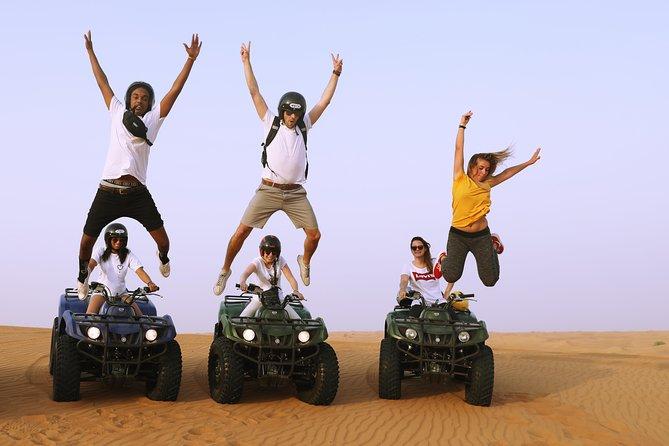 Self Drive Quad Bike, Sandboarding, Camel Ride and BBQ Meal at VIP Camp
