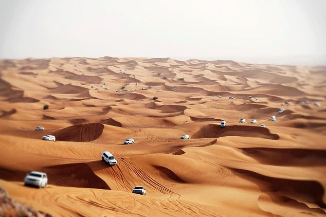 Dubai Evening 4x4 Desert Safari with BBQ, Sandboarding & Camel Ride photo 4