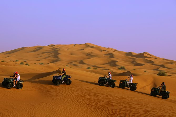 Self-Drive Quad Bike with BBQ Meal at Bedouin Camp, Camel rides and Sandboarding