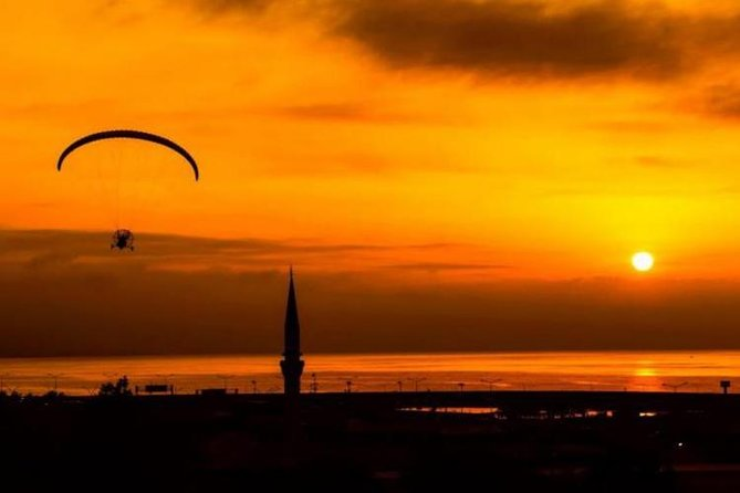 try parachuting with sunset view