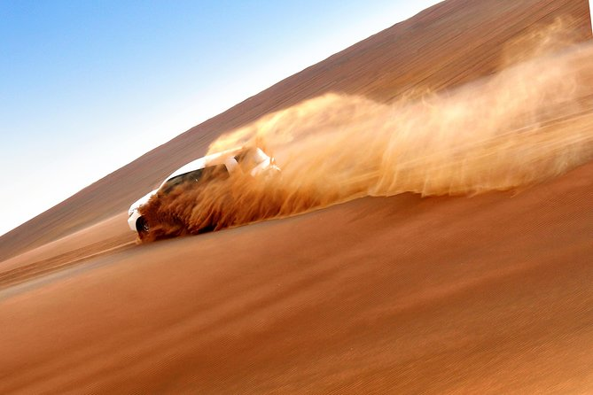 Abu Dhabi Royal Safari with Dune Bashing, Sunset Camel Ride, Sandboarding & BBQ