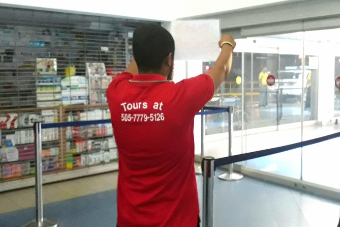 Tourguide holding a sign waiting for his customer at the airport