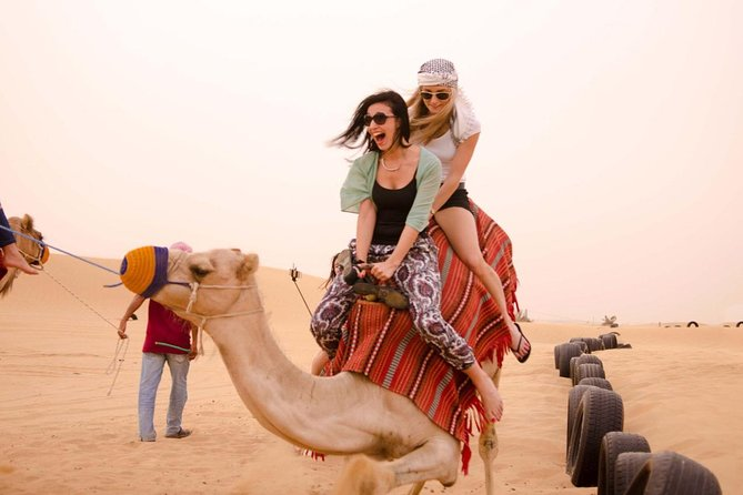 Camel Ride in Desert with Dune Bashing, BBQ Dinner and Belly Dance
