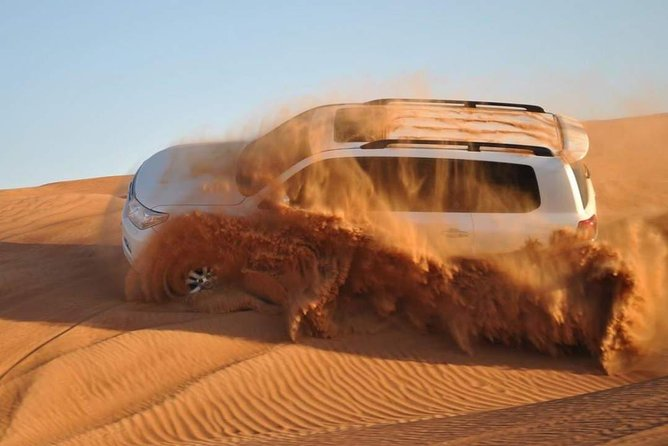 VIP Red Dunes Desert Safari , BBQ Dinner, Belly Dance & Fire Show