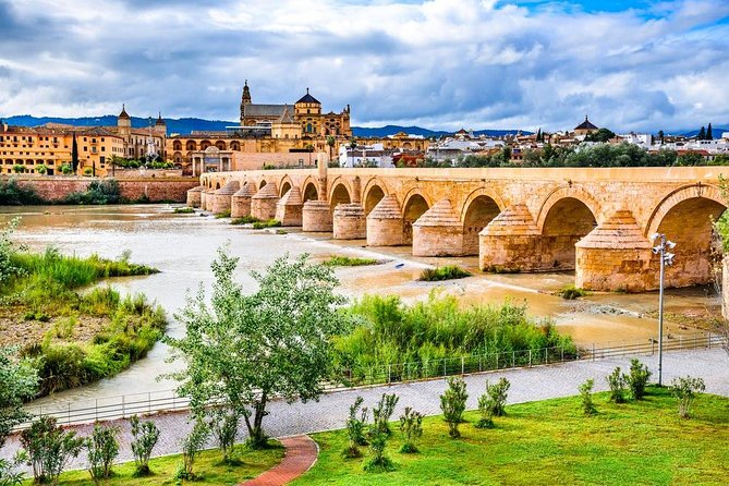 Luxury Cordoba guided tour from Granada finishing in Seville with Mercedes S-350