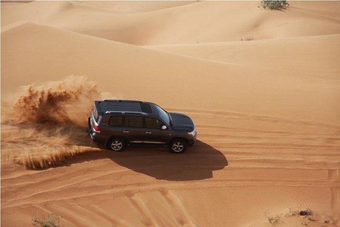 Full Day Desert safari Dune Bashing Camel Ride and BBQ meal