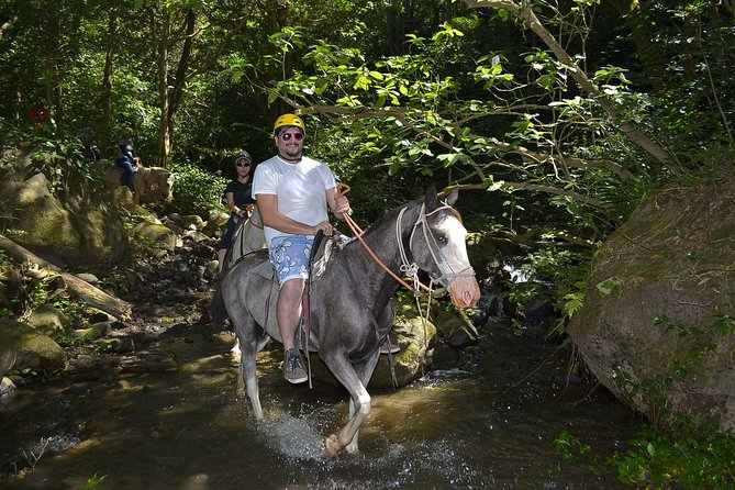 Tubing at Canyon River, Canopy, Horseback Ride and Hot Spring Combo Tour From Playa Hermosa