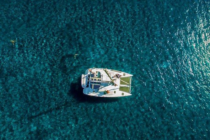Santorini Half Day Catamaran Private Cruise incl. Meal, Drinks & Free Transport