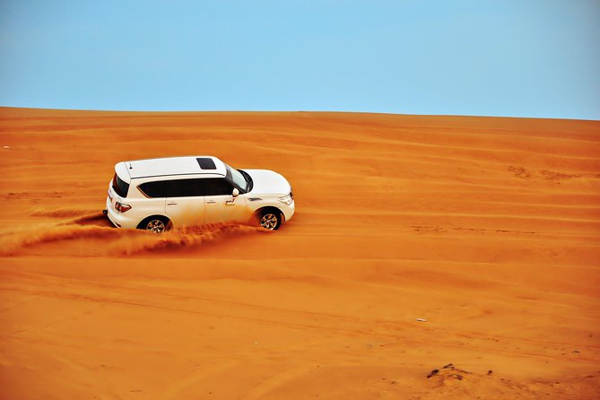 Red Dunes Desert Safari ,Tanura Show, Fire Show ,Bally Dance & BBQ Dinner