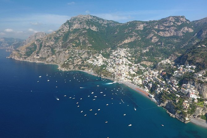 Cruise along the gorgeous Amalfi Coast on the way to and from Capri