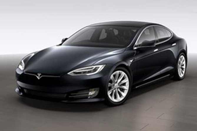 Getaway to a luxury eco holiday house with free Tesla hire and charging included