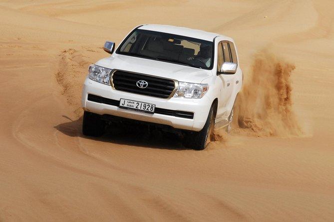 Premium Red Dune Desert Safari,BBQ dinner, camel ride, live show at Majilis camp