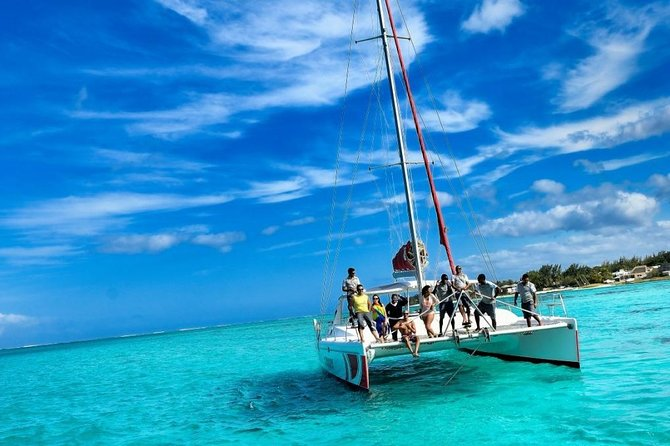 Catamaran Adventure Full Day: Ile aux cerfs,GRSE Waterfall,Snorkeling &BBQ Lunch