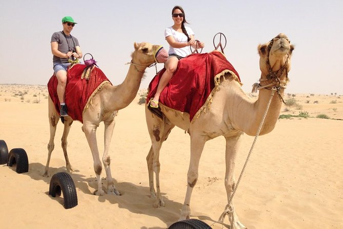 Morning Dubai Red Dunes Safari with Camel Riding and Sand Boarding
