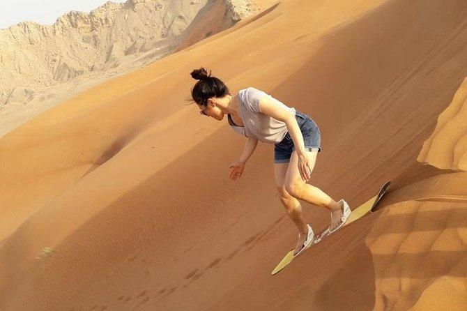 Camel Rock Desert safari Dubai with bbq Dinner camel ride sand boarding & more