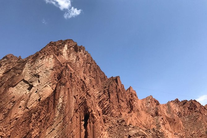 Private Day Tour to Kizil Caves and Tianshan Canyon from Urumqi by Air