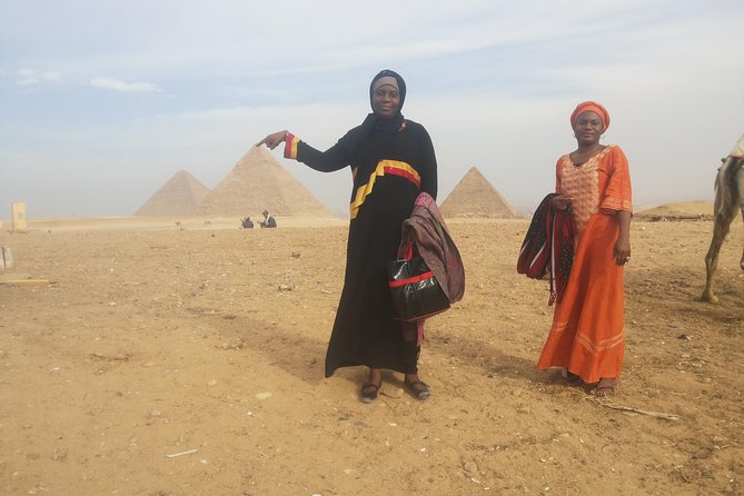 full day tour Giza pyramids Egyptian museum local bazaars from Cairo airport