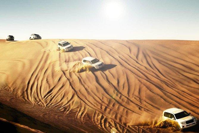 Dubai Desert Safari With BBQ Dinner, Camel Ride, Belly Dancing and sandboarding