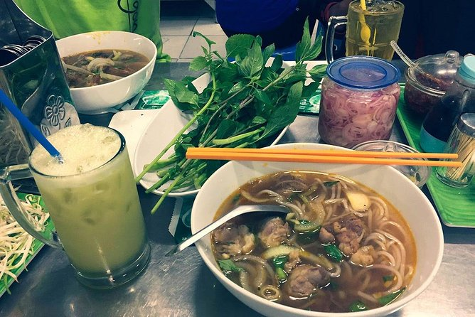 Afternoon Saigon Unseen Street Food Tour By Motorbike photo 8
